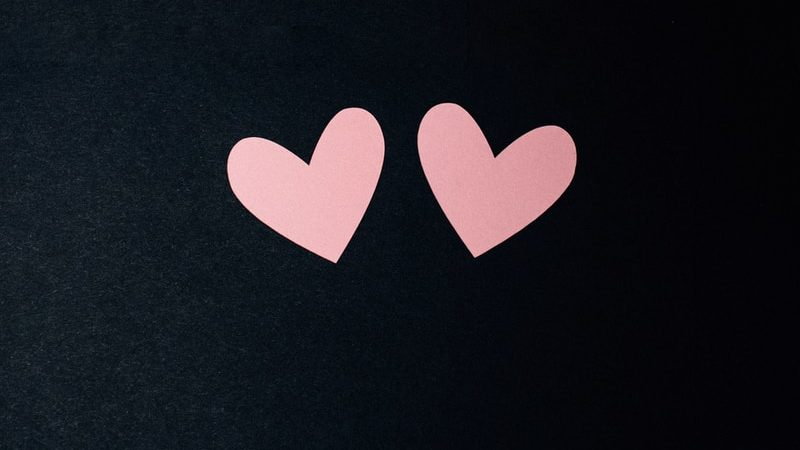 black and pink heart print textile